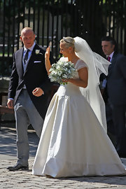 Zara Phillips was a blushing bride in a white drop-waist silk taffeta gown for her wedding to Mike Tindall. The blonde beauty donned an extravagant tulle veil and carried a bouquet of calla lilies. Her mother's Greek key tiara was perfect for the princess.
