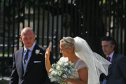 Mike Tindall and Zara Phillips depart after their Royal wedding at Canongate Kirk on July 30, 2011 in Edinburgh, Scotland. The Queen's granddaughter Zara Phillips will marry England rugby player Mike Tindall today at Canongate Kirk. Many royals are expected to attend including the Duke and Duchess of Cambridge.