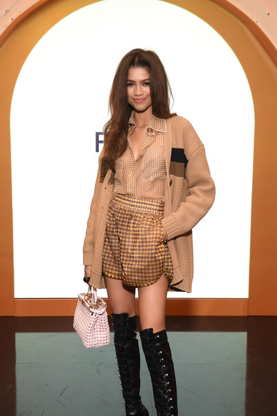Zendaya Coleman Leather Purse [fendi celebrates the launch of solar dream,the launch of solar dream,clothing,fashion model,thigh,fashion,leg,lady,beauty,footwear,knee,knee-high boot,zendaya,new york city,fendi,zendaya,euphoria,new york,fashion,getty images,actor,disney channel,instyle,model]