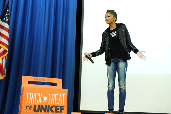 Zendaya Coleman Ripped Jeans [electric blue,textile,advertising,outerwear,denim,banner,jeans,fashion design,sleeve,curtain,zendaya,p.s. 163,spokesperson,alfred e. smith elementary,new york city,trick-or-treat for unicef]