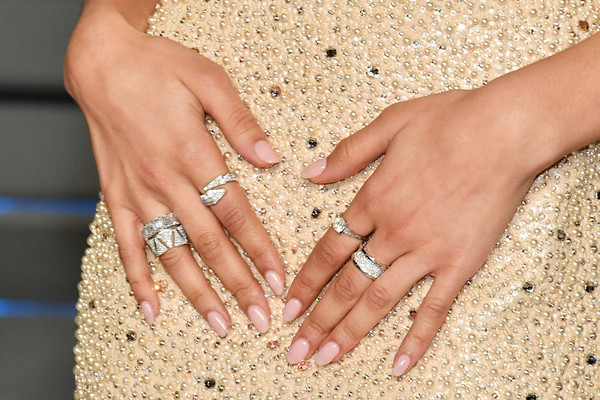 Zendaya Coleman Pink Nail Polish [nail,finger,hand,ring,wedding ring,manicure,wedding ceremony supply,nail care,engagement ring,jewellery,radhika jones - arrivals,zendaya,radhika jones,fashion detail,beverly hills,california,wallis annenberg center for the performing arts,oscar party,vanity fair]