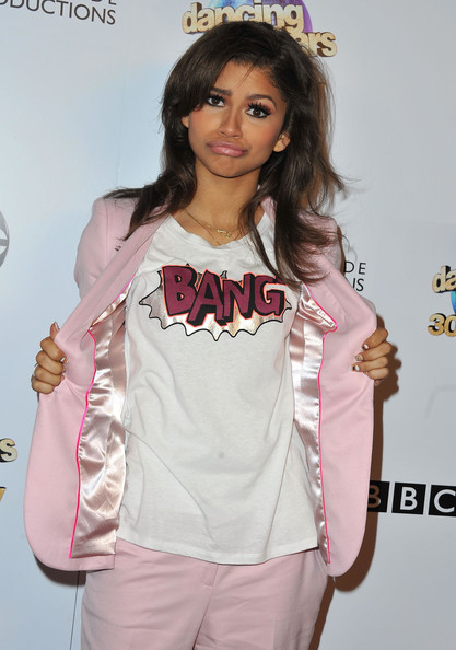 Zendaya Coleman Graphic Tee [dancing with the stars,white,clothing,pink,hairstyle,outerwear,lip,brown hair,long hair,jacket,costume,zendaya coleman,california,hollywood,abc,episode celebration,boulevard3]