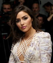 Olivia Culpo framed her gorgeous face with a side-parted wavy hairstyle for the Zimmermann fashion show.