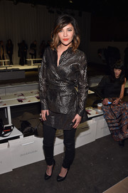 Jessica Szohr opted to wear her chic dress with a pair of black leather pants.