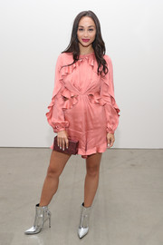 Cara Santana went the frilly route with this coral ruffle romper for the Zimmermann fashion show.