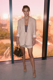 Nina Agdal styled her look with a pair of strappy nude patent sandals.