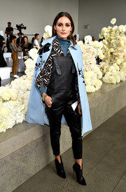 Olivia Palermo finished off her outfit with a baby-blue floral cape.