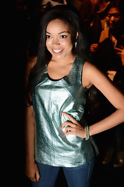 Dionne Bromfield opted for a metallic fitted top to show her style at the Zoe Jordan runway show in London.