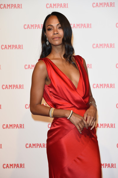 Zoe Saldana Bangle Bracelet [red diaries,the legend of red hand,movie,clothing,shoulder,red,fashion model,joint,formal wear,cocktail dress,dress,long hair,premiere,dress,earrings,zoe saldana,campari,campari red diaries,red carpet premiere,premiere]