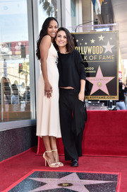 Mila Kunis kept it simple in a loose black sweater during Zoe Saldana's Walk of Fame Star ceremony.
