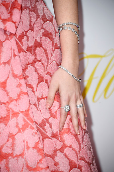 Zoey Deutch Tennis Bracelet [pink,skin,peach,nail,hand,dress,finger,wrist,close-up,jewellery,arrivals,zoey deutch,flower,jewelry detail,california,hollywood,arclight cinemas,the orchard,premiere,premiere]