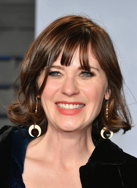 Zooey Deschanel Short Curls [hair,eyebrow,hairstyle,beauty,human hair color,chin,layered hair,smile,bangs,long hair,zooey deschanel,radhika jones - arrivals,radhika jones,hair,hairstyle,celebrity,eyebrow,beauty,oscar party,vanity fair,zooey deschanel,new girl,united states of america,image,actor,singer-songwriter,celebrity,she him]