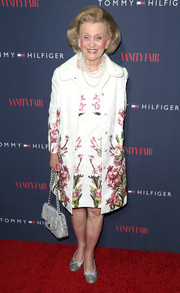 Barbara Davis was vintage-chic in this floral coat and dress ensemble during the Zooey Deschanel and Tommy Hilfiger collection debut.