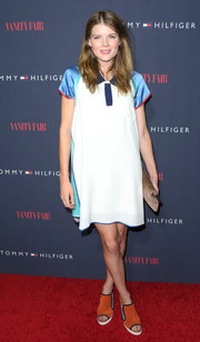 Emma Greenwell kept it casual in a white and blue day dress during the Zooey Deschanel and Tommy Hilfiger collection debut.