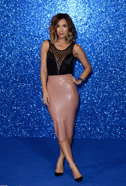 Myleene Klass kept the sexy vibe going with a pink latex pencil skirt.