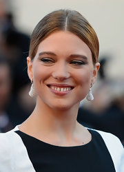 Lea Seydoux topped off her super modern look with this center-parted sleek bun.