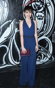 Sami Gayle looked effortlessly chic in a pleated blue jumpsuit by Alice + Olivia during the label's fashion show.