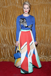 Kate Nash chose a bold colored skirt by Alice + Olivia for their NYFW presentation.
