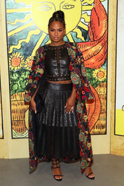 Christina Milian matched her skirt with a grommeted leather and lace crop-top.