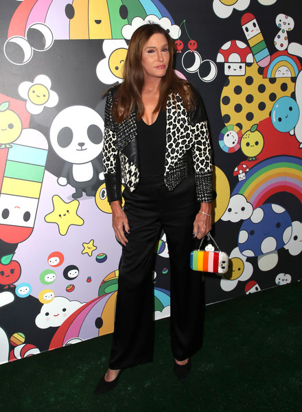 Caitlyn Jenner attended the alice + olivia x FriendsWithYou collection launch wearing a cropped jacket with leopard and houndstooth panels.