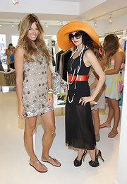 Kelly Bensimon celebrated the launch of her jewelry line in a taupe mini dress paired with a leather and rhinestone cuff.