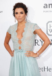 Eva Longoria attended the amfAR Cinema Against AIDS Gala wearing a lovely diamond flower bracelet and matching earrings.