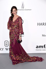 Georgina Chapman attended the amfAR Cinema Against AIDS Gala looking like a fashion goddess, as usual, in a floral-embroidered purple gown by Marchesa.