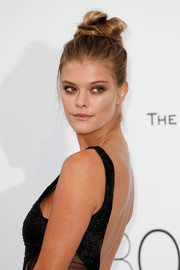 Nina Agdal sported a messy top knot at the amfAR Cinema Against AIDS Gala.