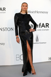 Natasha Poly looked quite the glamazon in her fully sequined, high-slit black gown at the amfAR Cinema Against AIDS Gala.