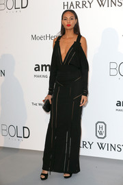 Joan Smalls smoldered at the amfAR Cinema Against AIDS Gala in a black Givenchy cold-shoulder gown boasting a plunging neckline and multiple sheer inserts.