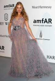 Paris Hilton looked frilly at the amfAR Cinema Against AIDS Gala in a gray and pink gown with a bejeweled waist.
