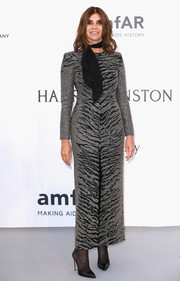 Carine Roitfeld attended the amfAR Cinema Against AIDS Gala wearing a sparkly gray tiger-patterned dress.