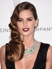 Izabel Goulart brought a dose of Old Hollywood glamour to the amfAR Cinema Against AIDS Gala with this vintage-style side sweep.