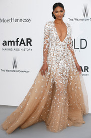 Chanel Iman made jaws drop at the amfAR Cinema Against AIDS Gala with this stunner of a gown, a Zuhair Murad Couture confection in nude with white floral embroidery.