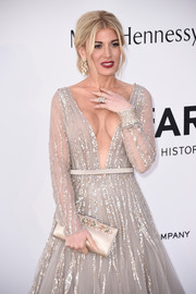 Hofit Golan paired a bejeweled satin clutch with a gorgeous gray gown for the amfAR Cinema Against AIDS Gala.