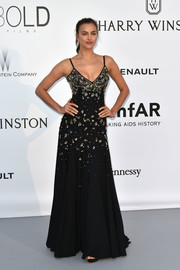 Irina Shayk donned a classic beaded gown by Miu Miu for the amfAR Cinema Against AIDS Gala.