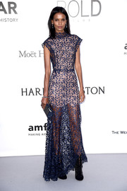 Liya Kebede opted for a simple blue Azzedine Alaia lace gown with a nude underlay when she attended the amfAR Cinema Against AIDS Gala.