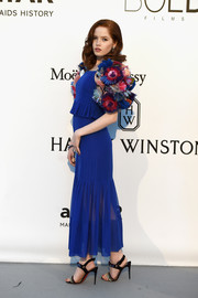 Ellie Bamber was all abloom in a royal-blue Chanel Couture peplum dress with a matching flower-festooned bolero during the amfAR Cinema Against AIDS Gala.