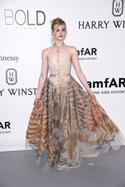 Elle Fanning looked enchanting at the amfAR Cinema Against AIDS Gala in a Valentino Haute Couture peacock-print gown.