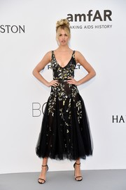 Hailey Clauson was prom-glam in a tea-length embroidered dress by J. Mendel at the amfAR Gala Cannes 2017.