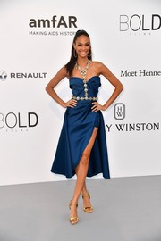 Joan Smalls looked effortlessly chic in a blue Elie Saab Couture dress with bejeweled harness detailing at the amfAR Gala Cannes 2017.