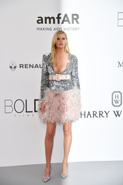 Lara Stone added more shine with a pair of silver pumps.