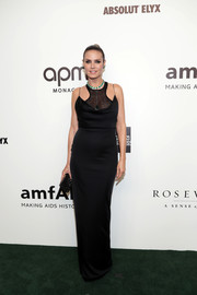Heidi Klum complemented her gown with a beaded clutch by Jimmy Choo.