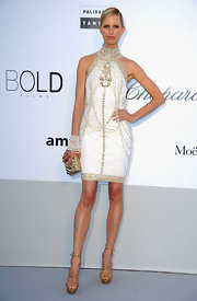 Karolina Kurkova channeled the '20s in sultry strappy gold Ontario sandals.