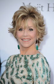 Jane Fonda paired her sequined gown with emerald drop earrings at the red carpet at the amfAR Gala.