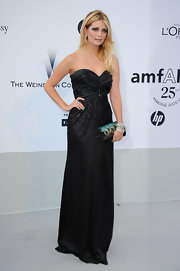 Mischa Barton glammed it up at the amfAR gala with a black satin clutch adorned with peacock feathers clutch.
