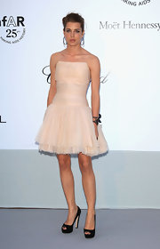 Charlotte opted for an ultra feminine pale pink cocktail dress, complete with a fitted bodice and a layered tulle skirt.