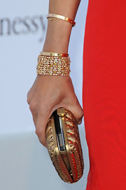 Afef Jnifen's layered diamond bracelets sparkled at the 64th annual Cannes Film Festival.