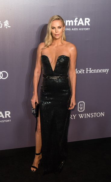 Charlize Theron complemented her gown with black ankle-strap sandals by Gianvito Rossi.