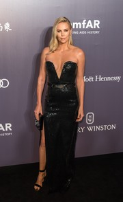 Charlize Theron donned a show-stopping strapless sequin gown by Saint Laurent, boasting a plunging sweetheart neckline and a high side slit, at the amfAR Hong Kong Gala.